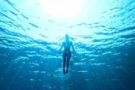 swimming underwater - woman