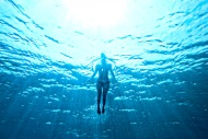 swimming underwater - woman